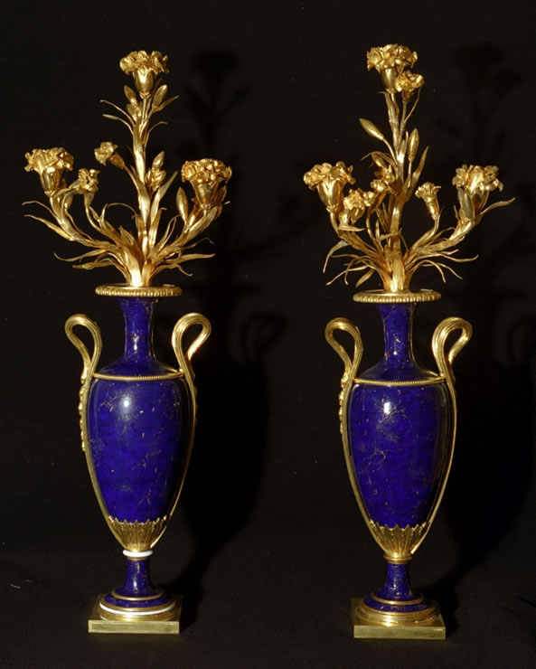 Pair of neoclassical ormoulu and Sèvres porcelain candelabra.