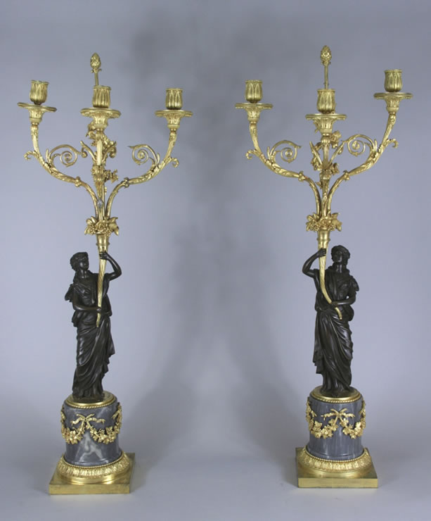 Pair three light candelabra with patinated figures