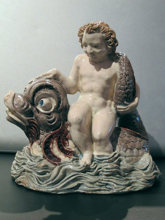 Fontainebleau glazed figure of a boy on a dolphin