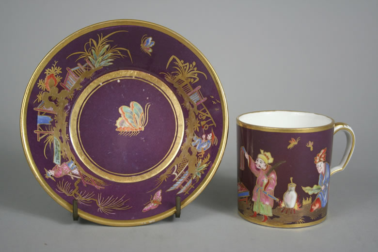 Purple ground chinoiserie cup and saucer