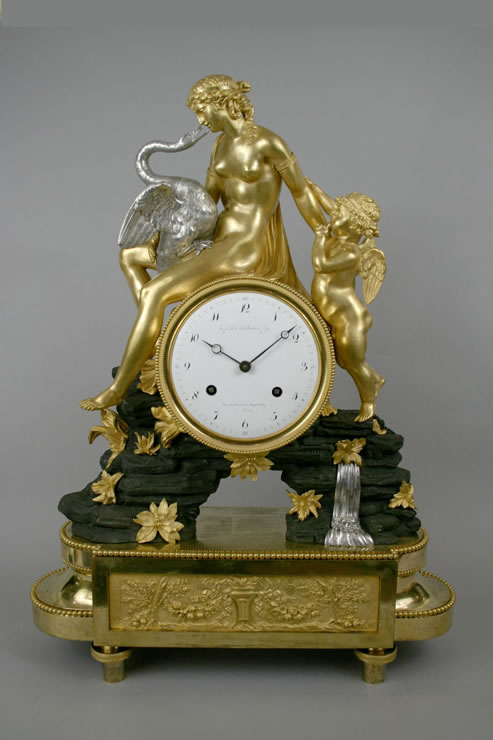 Directoire ormoulu, bronze patiné and silvered bronze mantel clock by Deverberie